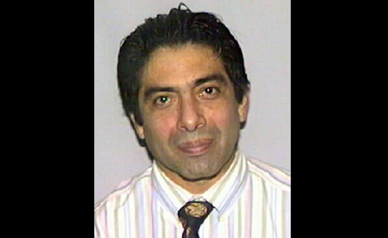 This undated photo provided by the Office of the Attorney General of Florida shows fugitive Miami Dr. Armando Angulo. Angulo, charged in the nation's largest prosecution of Internet pharmacies, is getting off in part because of the huge volume of evidence in his case: more than 400,000 documents and two terabytes of electronic data that federal authorities say is too expensive to maintain. The case started in 2003 with a raid of a small Iowa drugstore, Union Family Pharmacy in Dubuque, and dismantled two Internet pharmacies that illegally sold 30 million pills to customers. (AP Photo/Attorney General of Florida)