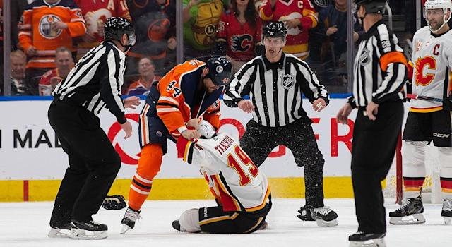 In a rekindling of their spat on Jan. 11, Zack Kassian and Matthew Tkachuk dropped the gloves on Wednesday night late in the first period. (Photo by Codie McLachlan/Getty Images)