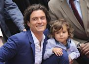 <p>Between the collared shirt and perfectly tousled hair, little Flynn is giving dad some serious competition for cute. <i>(Photo by Axelle/Bauer-Griffin/FilmMagic)</i><br></p>