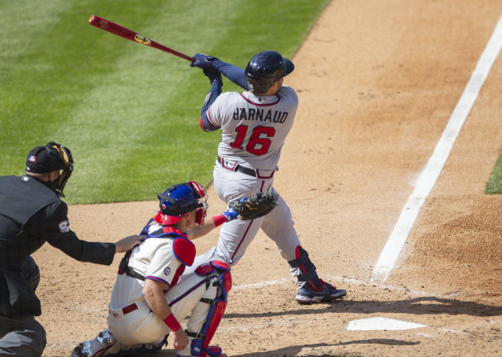 Atlanta Braves Travis d'Arnaud (16) follows through on a home run during the seventh inning of a baseball game against the Philadelphia Phillies, Sunday, April 4, 2021, in Philadelphia. (AP Photo/Laurence Kesterson)