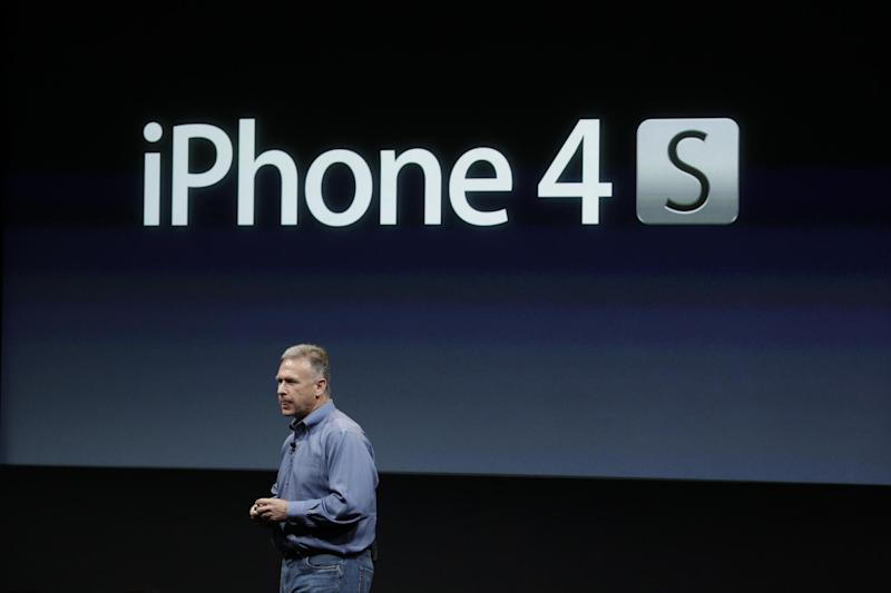 Apple's Phil Schiller talks about the iPhone 4S during an announcement at Apple headquarters in Cupertino, Calif., Tuesday, Oct. 4, 2011.  (AP Photo/Paul Sakuma)