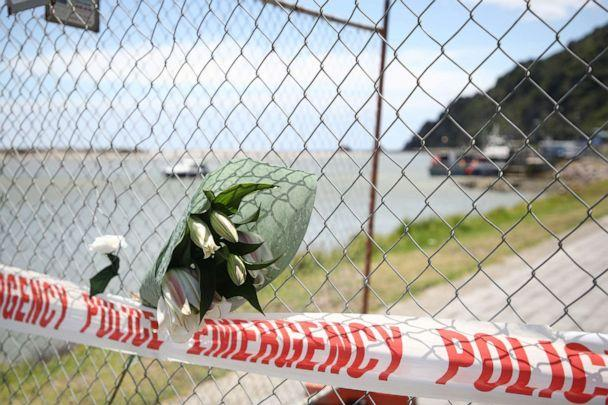 PHOTO: Floral tributes are placed on a fence at the Whakatane Wharf in Whakatane, New Zealand, Dec. 10, 2019. At least six people are dead and several others are missing following volcanic eruptions on White Island on Dec. 9, 2019. (Phil Walter/Getty Images)