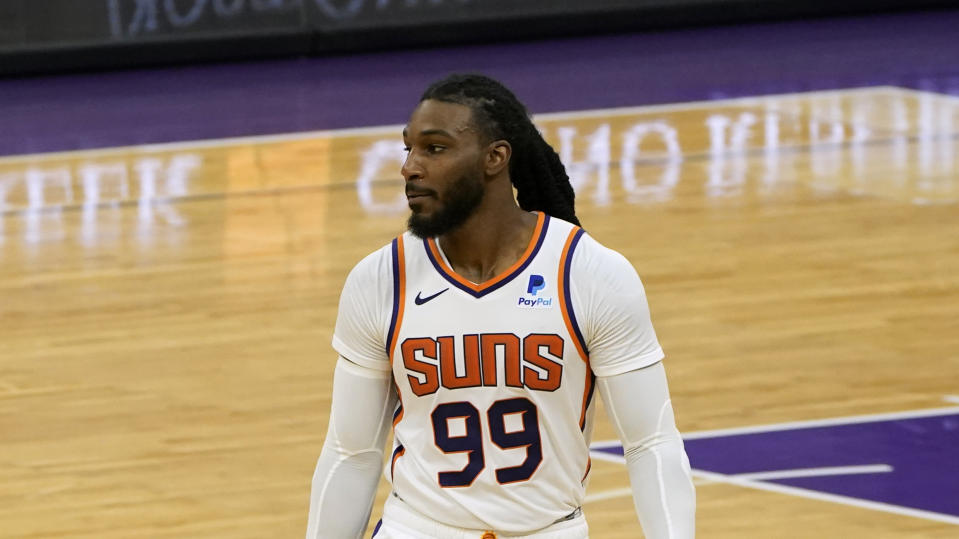 Phoenix Suns forward Jae Crowder, center, during the second half of an NBA basketball game against the Sacramento Kings in Sacramento, Calif., Saturday, Dec. 26, 2020. The Kings won 106-103. (AP Photo/Rich Pedroncelli)