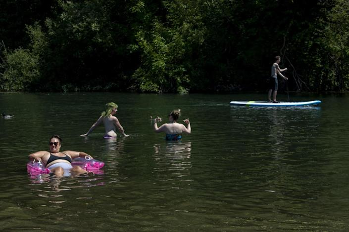 Beachgoers enjoy the cool water at Monte Rio Beach on the Russian River in Monte Rio, Calif.