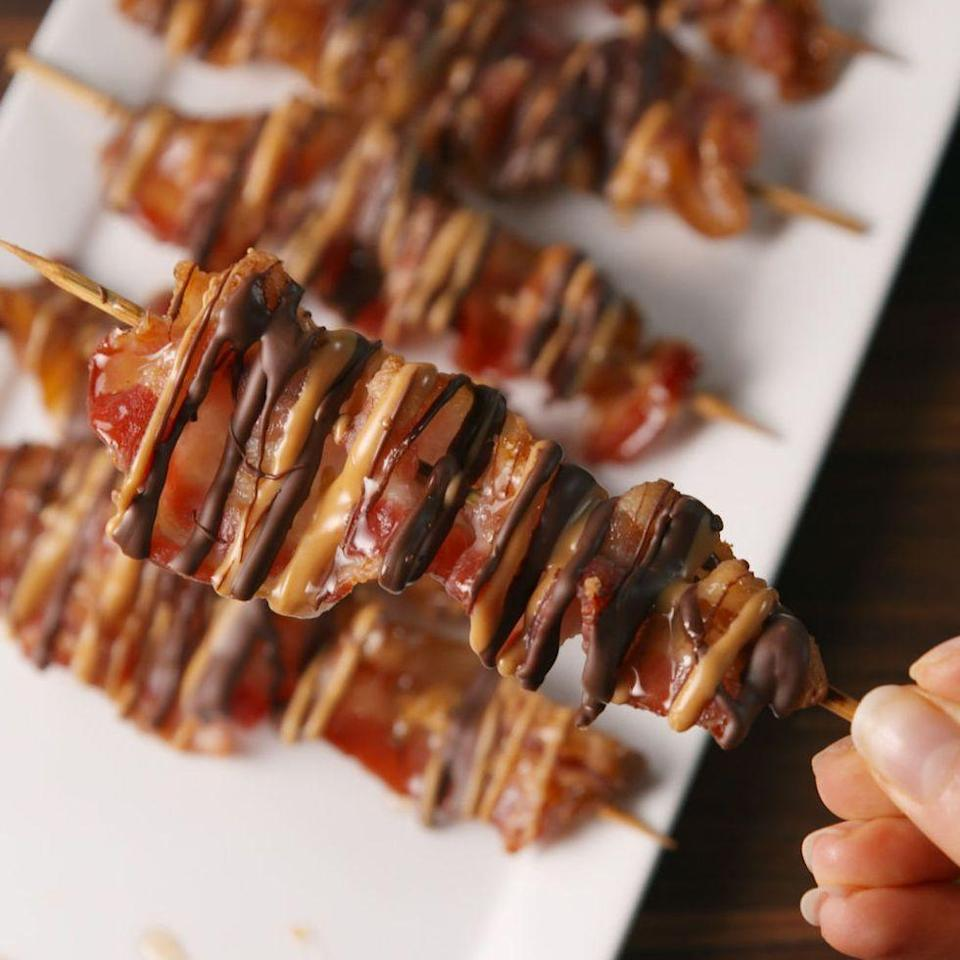 """<p>Chocolate and bacon are a match made in heaven.</p><p>Get the <a href=""""https://www.delish.com/uk/cooking/recipes/a28827701/chocolate-bacon-skewers-recipe/"""" rel=""""nofollow noopener"""" target=""""_blank"""" data-ylk=""""slk:Chocolate Bacon Skewers"""" class=""""link rapid-noclick-resp"""">Chocolate Bacon Skewers</a> recipe.</p>"""