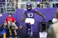 Minnesota Vikings running back Dalvin Cook (33) celebrates after a 19-yard touchdown run during the first half of an NFL football game against the Atlanta Falcons, Sunday, Sept. 8, 2019, in Minneapolis. (AP Photo/Bruce Kluckhohn)