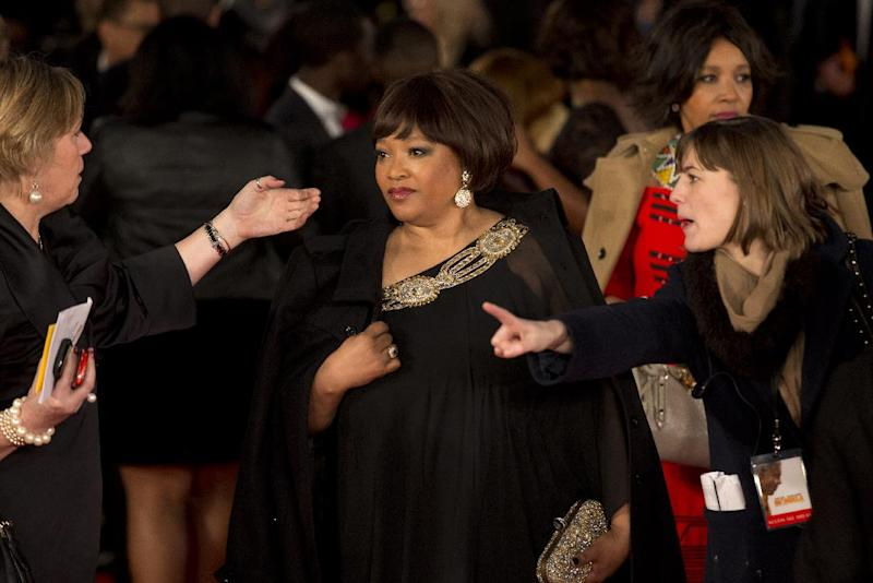 """Zindzi Mandela, center, the daughter of Nelson Mandela arrives to attend the UK premiere of the movie """"Mandela: Long Walk to Freedom"""" at a cinema in London, Thursday, Dec. 5, 2013. South African President Jacob Zuma announced later Thursday that former President Nelson Mandela has died aged 95, Zuma says """"we've lost our greatest son."""" In the movie Idris Elba plays Nelson Mandela and Naomie Harris plays Winnie Mandela. (AP Photo/Matt Dunham)"""