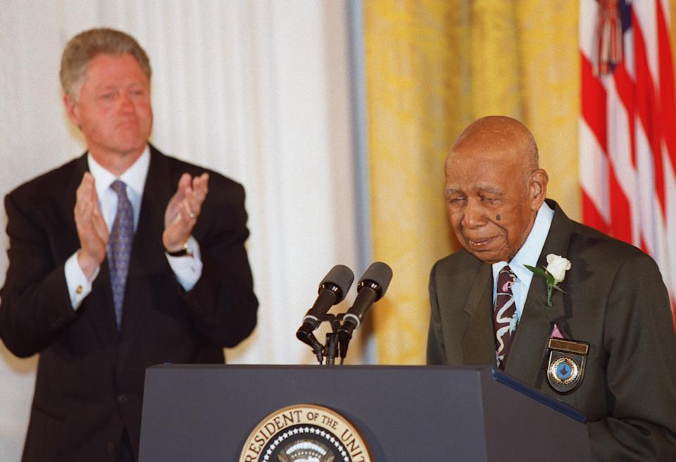 Ninety-four-year-old Herman Shaw speaks during ceremonies at the White House on May 16, 1997, in which President Clinton apologized to the survivors and families of the victims of the Tuskegee Syphilis Study. Shaw and hundreds of other Black men were part of a government study that followed the progress of syphilis and were told that they were being treated, but were actually given only a placebo. AFP PHOTO Paul J. RICHARDS (Photo credit should read PAUL J. RICHARDS/AFP via Getty Images)