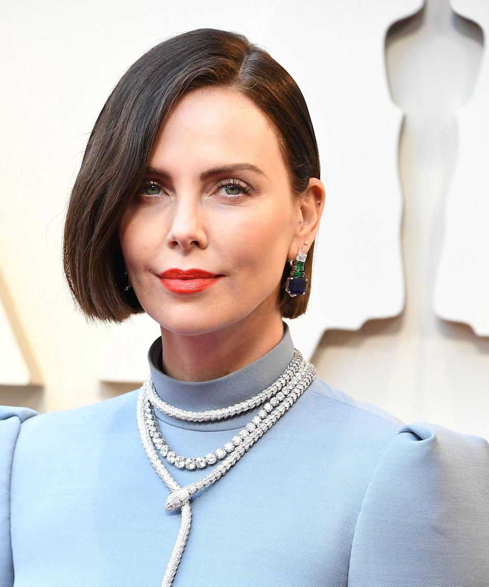 "<strong>Charlize Theron, 2019</strong><br><br>Sometimes the most newsworthy look is the simplest. Charlize Theron, who's known for her bright blonde hair, made us all do a double take on the 2019 carpet thanks to a dramatic hair makeover. Paired with an equally-chic, streamlined blue Dior dress, her fresh brown bob was one of our favorite looks from the night. <br><span class=""copyright"">Photo: Steve Granitz/WireImage.</span>"