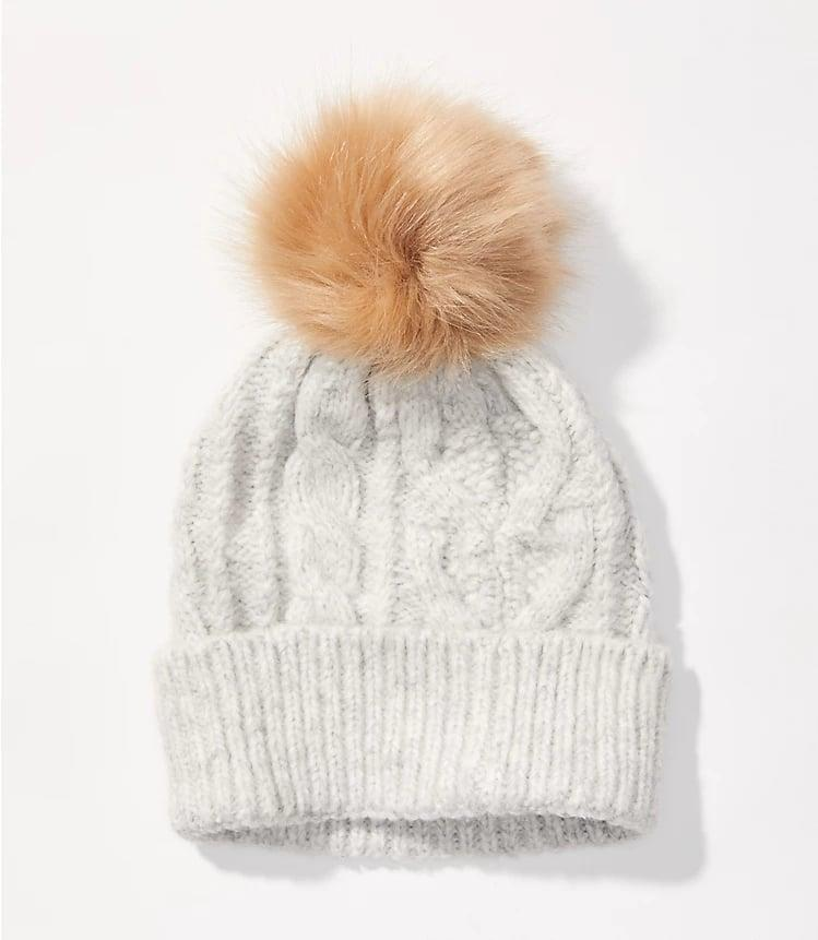 <p>An adorable addition to their winter accessories is this <span>Cable Pom Pom Hat</span> ($25). </p>