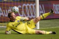 The ball gets past Sporting Kansas City goalkeeper Tim Melia for an FC Dallas goal during the first half of an MLS soccer match in Kansas City, Kan., Saturday, Sept. 19, 2020. (AP Photo/Orlin Wagner)