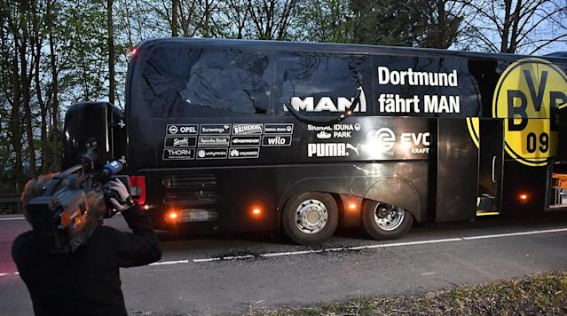 BERLIN (AP) A 28-year-old German-Russian citizen was arrested Friday in Germany on suspicion of bombing the bus carrying the Borussia Dortmund soccer team in an attack last week that prosecutors alleged was motivated by financial greed.