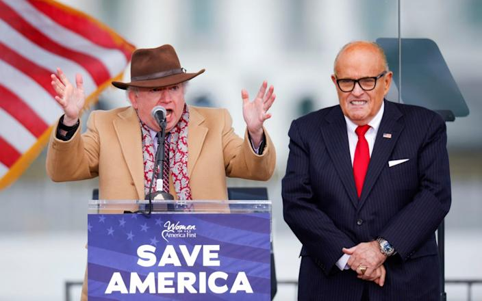 John Eastman and Rudy Giuliani at the rally last week - REUTERS