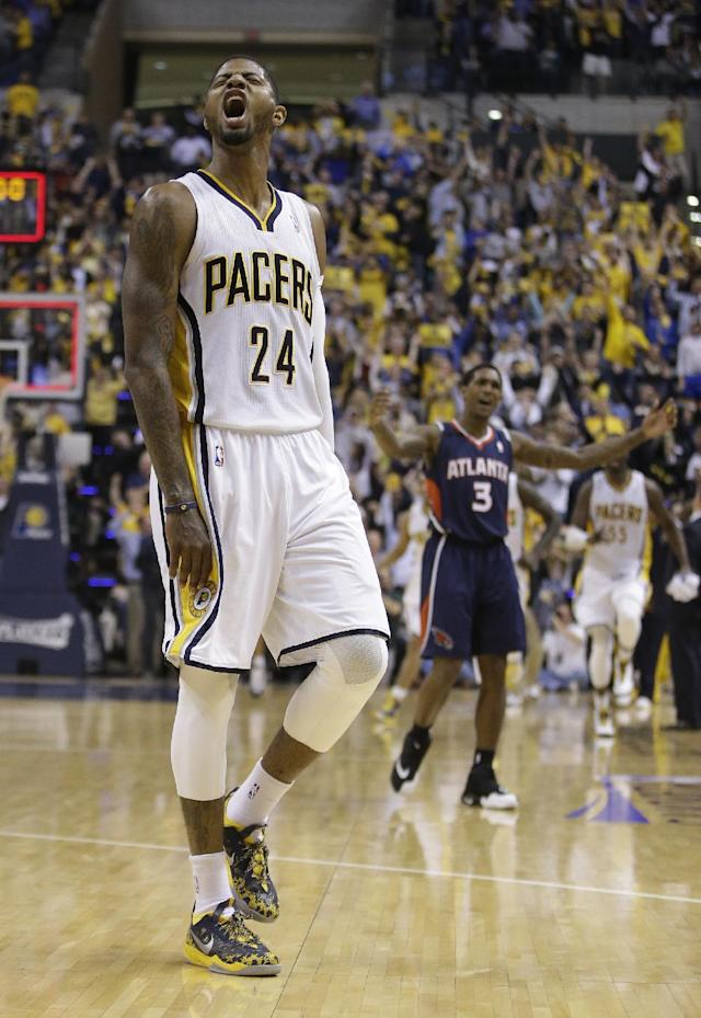 Indiana Pacers' Paul George (24) reacts after hitting a three-point shot at the end of the third quarter during Game 2 of an opening-round NBA basketball playoff series against the Atlanta Hawks Tuesday, April 22, 2014, in Indianapolis. Indiana defeated Atlanta 101-85. (AP Photo/Darron Cummings)