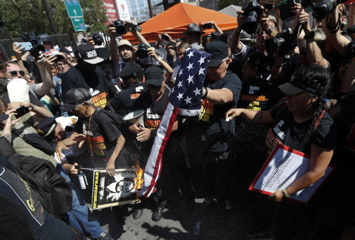 <p>Protesters burn an American flag during demonstration, July 20, 2016, in Cleveland, during the third day of the Republican convention. (Photo: John Minchillo/AP)</p>