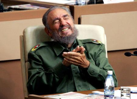 Then Cuban President Fidel Castro laughs during the year-end session of the Cuban parliament in Havana in this December 23, 2005 file photo. REUTERS/Claudia Daut/File Photo