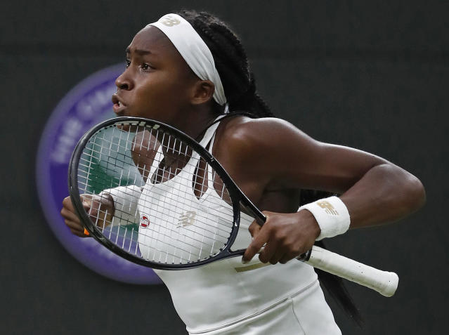 FILE - In this July 3, 2019, file photo, Coco Gauff celebrates after beating Slovakia's Magdalena Rybaikova in a women's singles match at the Wimbledon Tennis Championships in London. Gauff will get a chance to try for an encore: The 15-year-old from Florida received a wild-card entry Tuesday, Aug. 13, 2019, for the U.S. Open's main draw.It will be Gauff's second Grand Slam tournament. She made a magical run to the fourth round at Wimbledon last month after getting a wild card into the qualifying rounds there.(AP Photo/Alastair Grant, File)