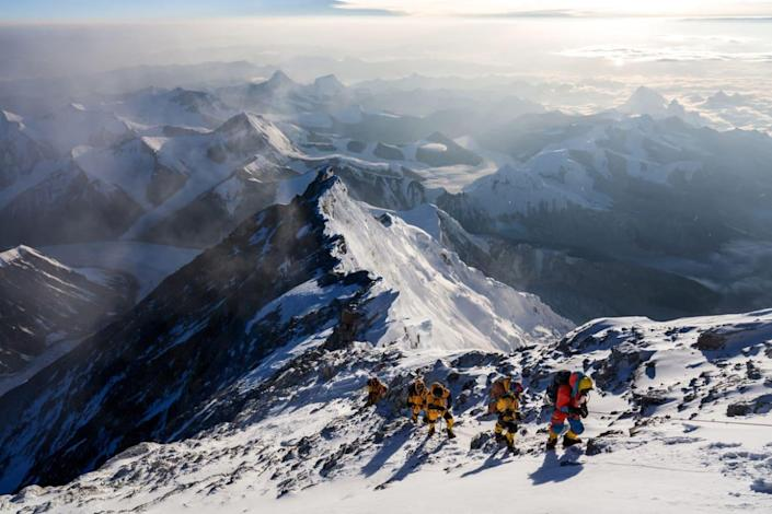 """<div class=""""inline-image__caption""""> <p>Team members during the expedition to find Sandy Irvine's remains on Mt. Everest, in attempt to solve one of the mountain's greatest mysteries: who was the first to summit Mt. Everest? </p> </div> <div class=""""inline-image__credit""""> National Geographic/Matt Irving </div>"""