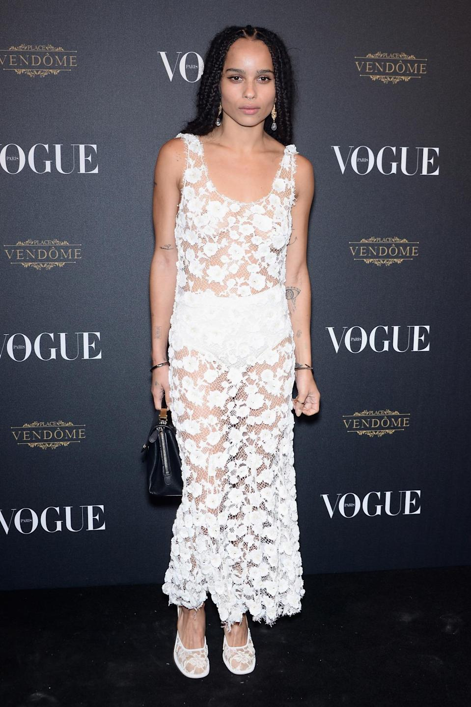 <p>To attend <i>Vogue Paris</i>'s 95th anniversary party, Kravitz—who's BFFs with former Balenciaga creative director Alexander Wang—wore a lacy, see-through dress and matching shoes from the designer's last collection for the house.<br></p>