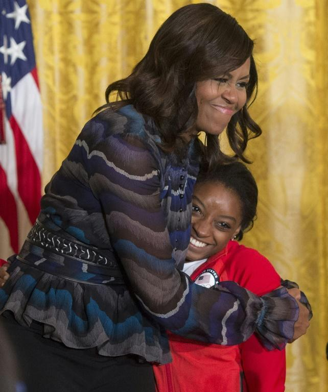 Former US first lady Michelle Obama led an outpouring of support for Simone Biles following her decision to withdraw from the Olympic team final on Tuesday
