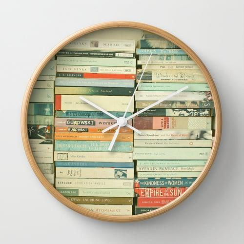 <p>We wish our walls were stocked with books, but we'll have to settle for the picture in this <span>Bookworm Wall Clock</span> ($32).</p>