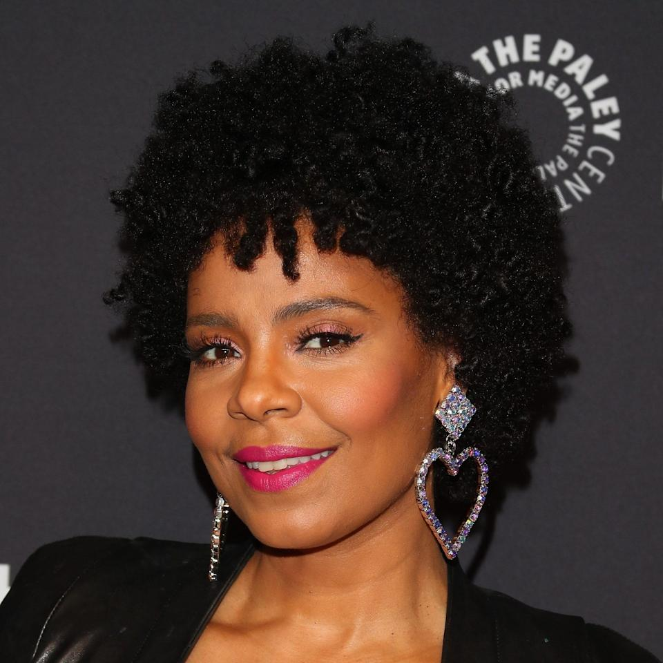 """<p>You can't go wrong with a natural hair look like Sanaa Lathan's. It goes with absolutely everything. Let it out and embrace those spirals. Tighter kinks and coils may want to try defining their pattern with a cream, <a href=""""https://www.allure.com/gallery/best-gels-for-curly-hair?mbid=synd_yahoo_rss"""" rel=""""nofollow noopener"""" target=""""_blank"""" data-ylk=""""slk:gel"""" class=""""link rapid-noclick-resp"""">gel</a>, or with styling methods like shingling or a <a href=""""https://www.allure.com/story/how-to-do-a-twist-out-hairstyle?mbid=synd_yahoo_rss"""" rel=""""nofollow noopener"""" target=""""_blank"""" data-ylk=""""slk:twist-out"""" class=""""link rapid-noclick-resp"""">twist-out</a>. </p> <p>To keep it frizz-free through the ceremony, try a curl cream like the <a href=""""https://shop-links.co/1745749960943989664"""" rel=""""nofollow noopener"""" target=""""_blank"""" data-ylk=""""slk:Maui Moisture Curl Quench + Coconut Oil Curl Smoothie"""" class=""""link rapid-noclick-resp"""">Maui Moisture Curl Quench + Coconut Oil Curl Smoothie</a>. It's filled with hydrating coconut oil, papaya butter, plumeria extract, and glycerin to leave your hair soft and shiny.</p>"""