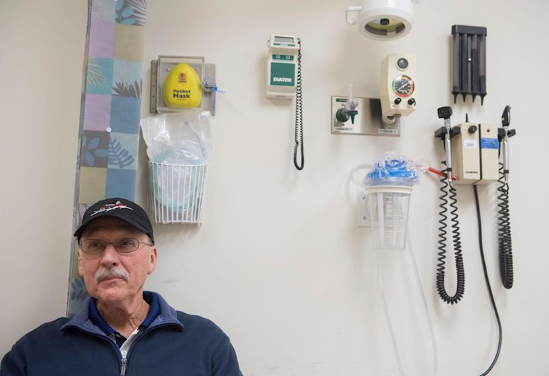 Patient Fred Janick, a survivor of metastatic cancer, waits to speak with Dr. Christian Hinrichs, an investigator at the National Cancer Institute in immunotherapy for HPV+ cancers, after a day of medical exams showing no recurrence of cancer, at the National Institutes of Health (NIH) in Bethesda, Maryland, February 8, 2018. Experimental trials are ongoing at the National Institutes of Health Clinical Center, a US government-funded research hospital where doctors are trying to partially replace patients' immune systems with T-cells that would specifically attack cancers caused by the human papillomavirus (HPV), a common sexually transmitted infection. A person's T-cells will naturally try to kill off any invader, including cancer, but usually fall short because tumors can mutate, hide, or simply overpower the immune system. Immunotherapies that have seen widespread success, such as chimeric antigen receptor (CAR-T) cell therapies, mainly target blood cancers like lymphoma, myeloma and leukemia, which have a tumor antigen -- like a flag or a signal -- on the surface of the cells so it is easy for immune cells to find and target the harmful cells. But many common cancers lack this clear, surface signal. Hinrichs' approach focuses on HPV tumors because they contain viral antigens that the immune system can easily recognize. / AFP PHOTO / SAUL LOEB (Photo credit should read SAUL LOEB/AFP/Getty Images)