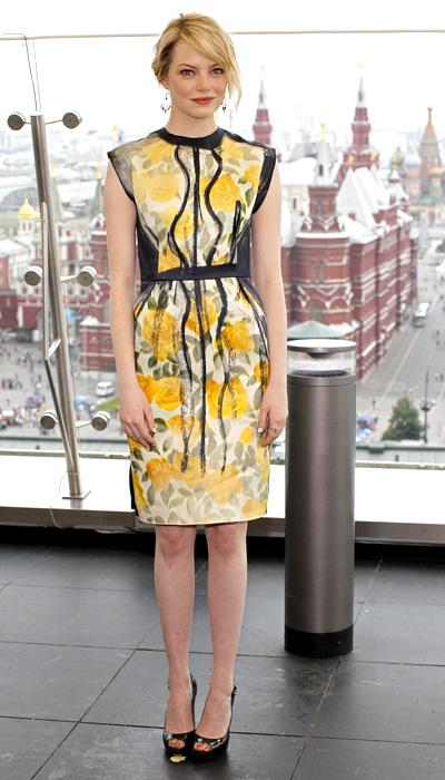 The lovely Emma Stone wears a pretty floral frock at the photo call for 'The Amazing Spider-Man' in Moscow, Russia, June 15. But before people start saying it looks like Grandma's curtains, on closer inspection the dress is more than just cute flowers: Black brushstrokes add a modern touch to this fun creation. (AP Photo/Misha Japaridze)