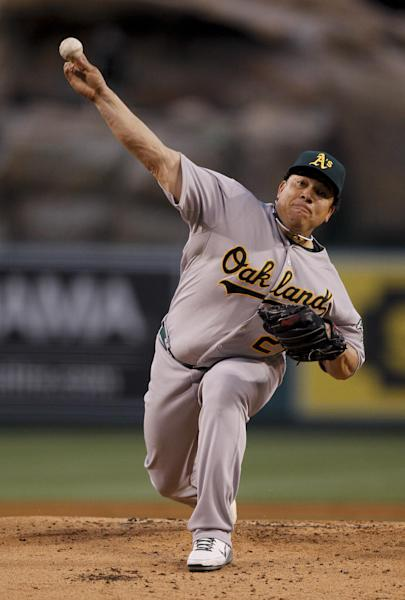 Oakland Athletics starting pitcher Bartolo Colon throws to the Los Angeles Angels during the first inning of a baseball game in Anaheim, Calif., Wednesday, April 18, 2012. (AP Photo/Chris Carlson)