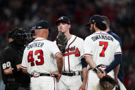 Atlanta Braves starting pitcher Max Fried (54) pulls on his lip as manager Brian Snitker (43) relieves him in the seventh inning of a baseball game against the New York Mets, Monday, May 17, 2021, in Atlanta. (AP Photo/John Bazemore)