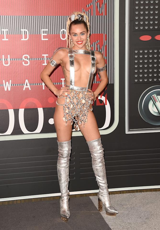 <p>Miley Miley Miley. What on earth were you thinking when you decided to pull this barely-there Versace number out of the closet?<br /><i>[Photo: Getty]</i> </p>