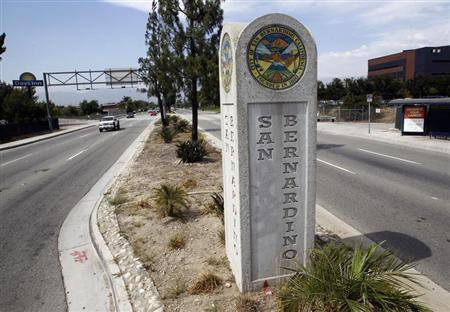 A concrete sign marks the city limits for San Bernardino, California