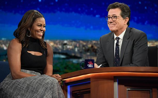 """<p>Sitting down with Stephen Colbert on <i>The Late Show</i>, Michelle Obama looked sophisticated with a fashion twist wearing extremely wide-leg gray trousers with a black sleeveless turtleneck. The sweater added a lit """"swag"""" to the ensemble with a chest cutout revealing some skin. She talked with the host about Beyoncé, Let Girls Learn, and some of her """"first lady faux pas."""" <i>(Photo: CBS)</i><br></p>"""