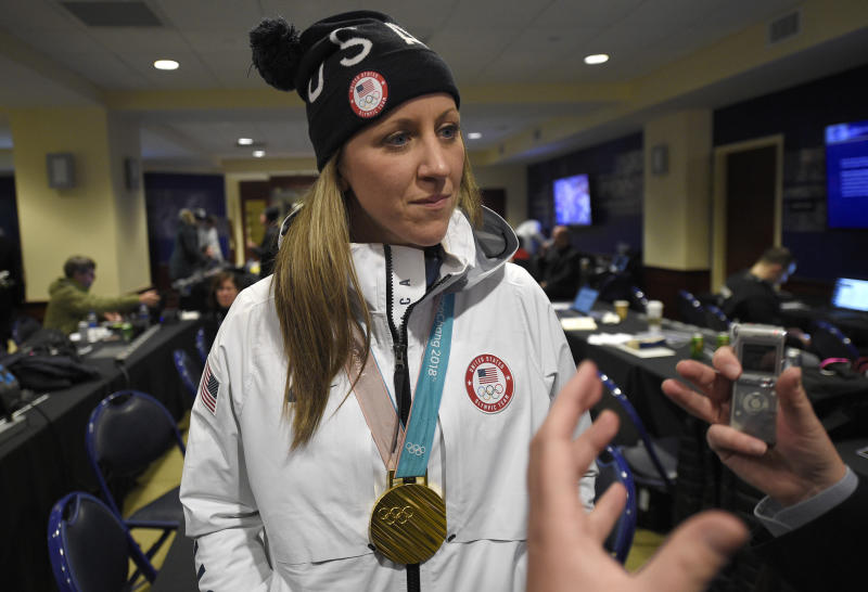 FILE - In this Saturday, March 3, 2018, file photo, Meghan Duggan, of the gold medal winning U.S. women's Olympic hockey team, listens to a question from the media before an outdoor NHL hockey game between the Washington Capitals and the Toronto Maple Leafs, in Annapolis, Md. The leading female hockey players in Sweden were refusing to attend a training camp Thursday, Aug. 15, 2019, or play in an upcoming international tournament in Finland over a pay dispute with the country's federation. Among those coming out in support of the Swedish players was Duggan.(AP Photo/Nick Wass, File)