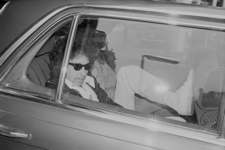 <p>Bob Dylan sitting inside a car while travelling to Earls Court, UK, London on June 15, 1978.</p>