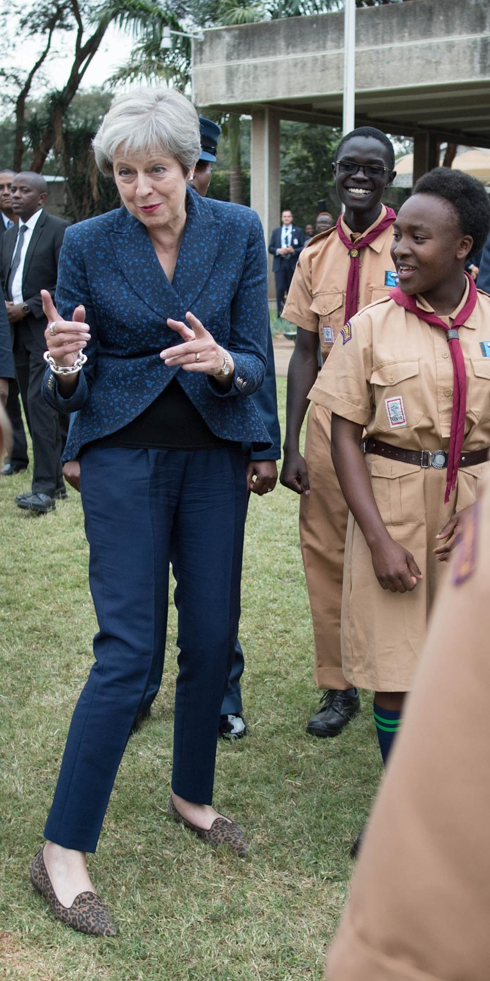 "Theresa May broke into dance and debuted the ""Maybot"" whilst meeting with scouts at the United Nations offices in Nairobi, Kenya on the third day of her visit to Africa. Photo dated 30/08/2018 (PA)"