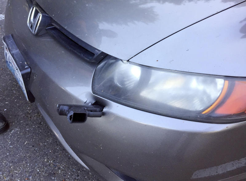 Washington State Patrol investigates how a handgun ended up in driver's bumper