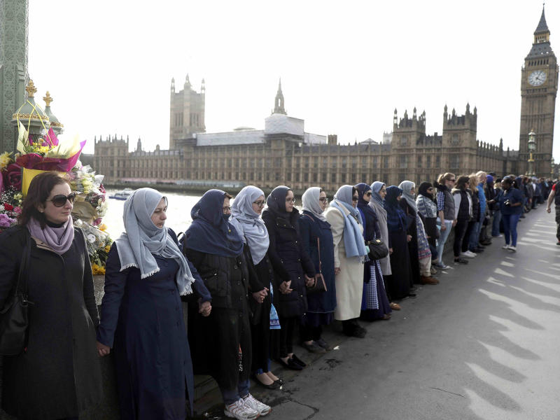 The women held hands in silence to remember victims of the terror attack in Westminster: Reuters
