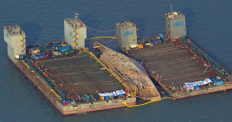 The damaged Sewol ferry was held afloat between two barges during a salvage operation off the South Korean island of Jindo, on March 23, 2017