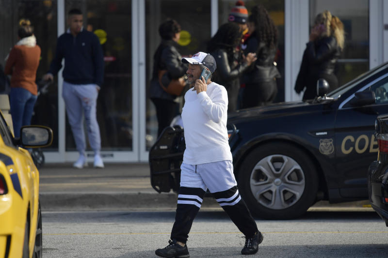 A man walks to his vehicle as authorities investigate an incident at Cumbnerland Mall, Saturday, Dec. 14, 2019, in Smyrna, Ga. (AP Photo/Mike Stewart)