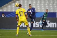 France's Kylian Mbappe passes the ball over Sweden's Viktor Claesson during the UEFA Nations League soccer match between France and Sweden at the Stade de France stadium in Saint-Denis, northern Paris, Tuesday, Nov. 17, 2020. (AP Photo/Francois Mori)