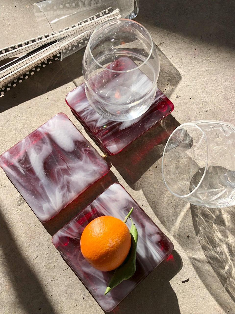 "<h2>Limited Batch Marbled Glass Coaster</h2><br>For the fancy cocktail holder or wine enthusiast in your life. <br><br><em>Shop <strong><a href=""https://www.etsy.com/shop/MadeByRheal"" rel=""nofollow noopener"" target=""_blank"" data-ylk=""slk:MadeByRheal"" class=""link rapid-noclick-resp"">MadeByRheal</a></strong></em><br><br><strong>MadeByRheal</strong> Limited Batch Marbled Glass Coaster, $, available at <a href=""https://go.skimresources.com/?id=30283X879131&url=https%3A%2F%2Fwww.etsy.com%2Flisting%2F592959899%2Flimited-batch-marbled-glass-coaster-set"" rel=""nofollow noopener"" target=""_blank"" data-ylk=""slk:Etsy"" class=""link rapid-noclick-resp"">Etsy</a>"