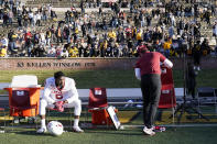 Arkansas defensive lineman Dorian Gerald sits on the bench following a 50-48 loss to Missouri in an NCAA college football game Saturday, Dec. 5, 2020, in Columbia, Mo. Missouri won the game on a last-second field goal by Harrison Mevis. (AP Photo/L.G. Patterson)