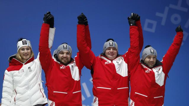 Medals Ceremony - Luge - Pyeongchang 2018 Winter Olympic Games - Team Relay - Medals Plaza - Pyeongchang, South Korea - February 16, 2018 - Bronze medalists Madeleine Egle, David Gleirscher, Peter Penz and Georg Fischler of Austria on the podium. REUTERS/Kim Hong-Ji