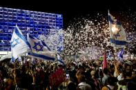 Supporters of the new Israeli government celebrate in Tel Aviv