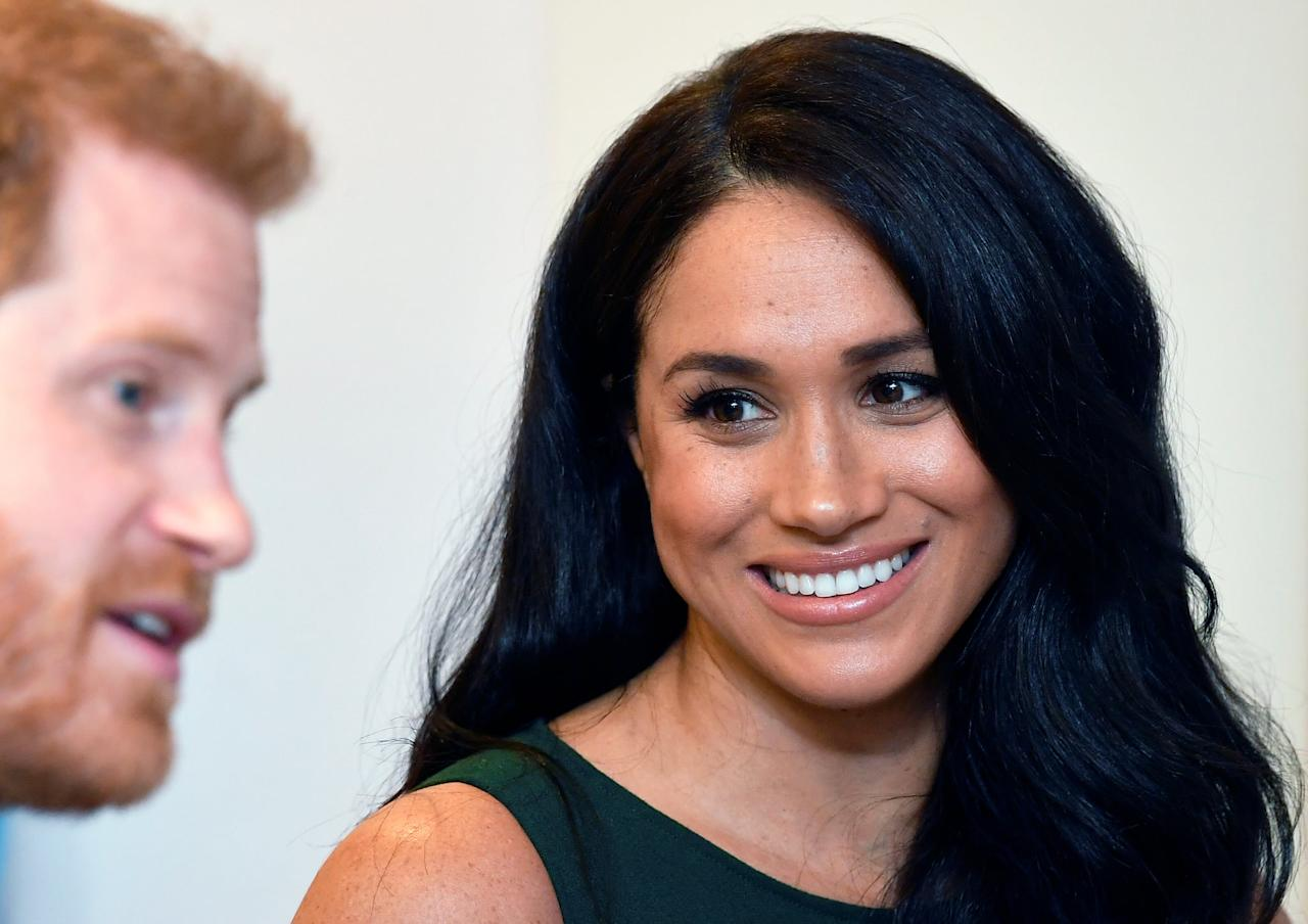<p>Neutral shades are customary for members of the royal family, but Markle makes the color look more fresh with a little gloss on top. </p>