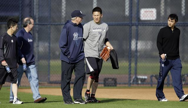 New York Yankees pitcher Masahiro Tanaka, center right, of Japan, talks to pitching coach Larry Rothschild, center left, during practice at the Yankees' minor league facility Thursday, Feb. 13, 2014, in Tampa, Fla. (AP Photo/Chris O'Meara)