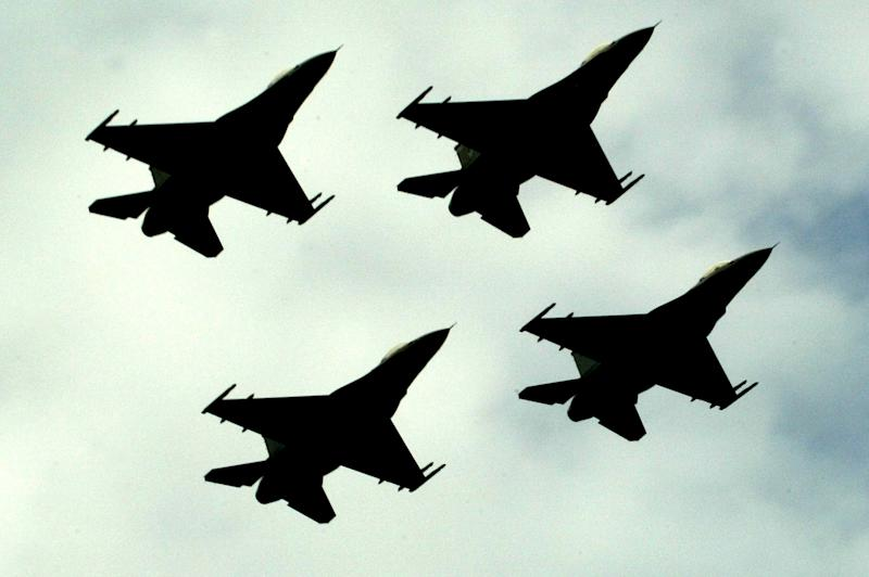 FILE - This March 23, 2005 file photo shows Pakistan Air Force F-16 fighter jets fly in formation during a Pakistan National Day ceremony in Islamabad, Pakistan. U.S. and Pakistani officials say Pakistan's intelligence chief will head to Washington late this month to resume counterterrorism talks suspended over a deadly border incident last year that killed two dozen Pakistani troops. (AP Photo/B. K. Bangash, File)