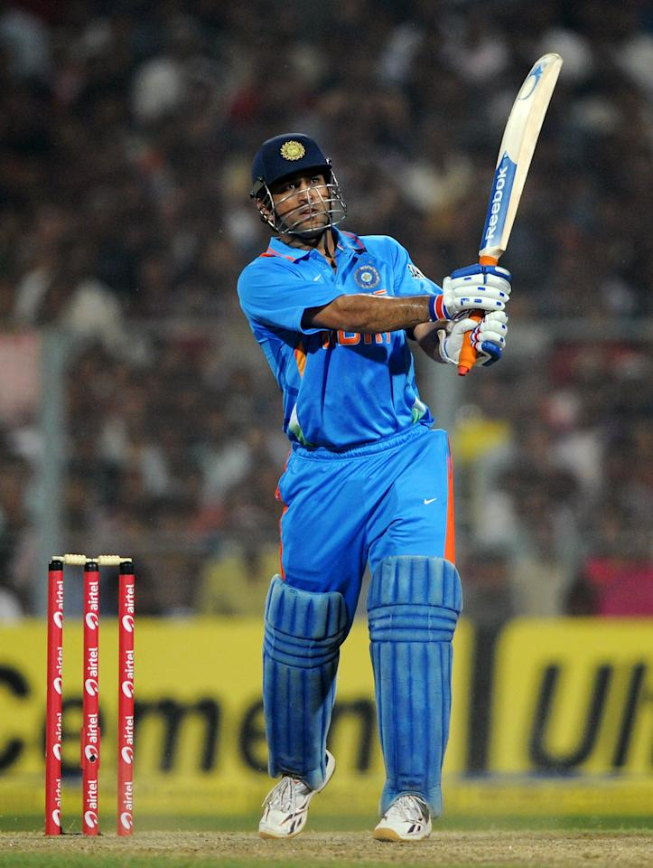 KOLKATA, INDIA - OCTOBER 29:  India captain MS Dhoni hits out for six runs during the Twenty20 International match between India and England at Eden Gardens on October 29, 2011 in Kolkata, India.  (Photo by Gareth Copley/Getty Images)