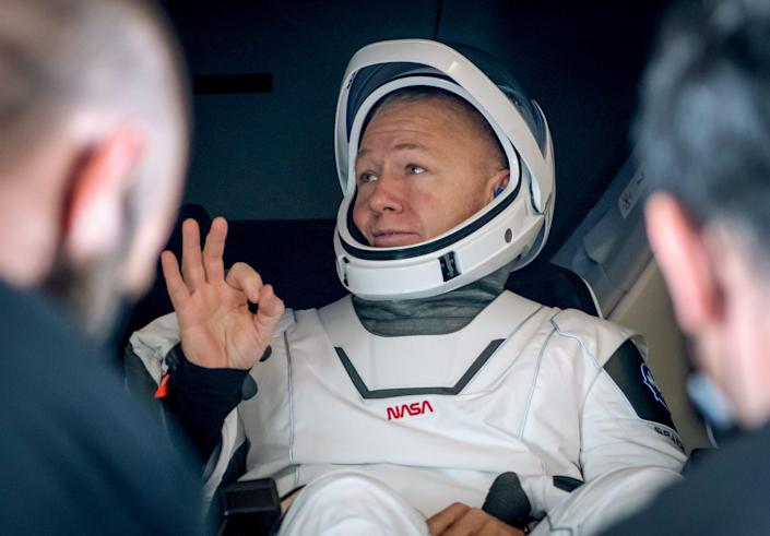 """<br>NASA astronaut Doug Hurley gives the OK sign while being helped out of SpaceX's Crew Dragon """"Endeavour"""" spacecraft in the Gulf of Mexico on August 2, 2020."""